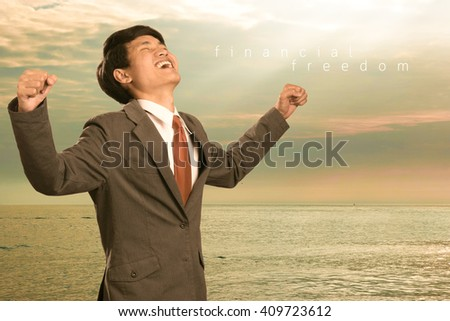 Business man celebrates freedom success arms raised looking up to sky. Financial freedom concept - stock photo