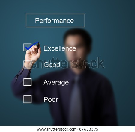 business man checking  excellence on performance evaluation form