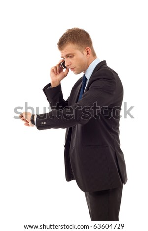 business man checking time and talking to a phone