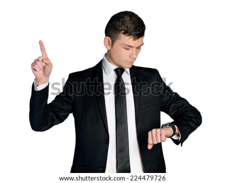 Business man checking watch and pointing up - stock photo