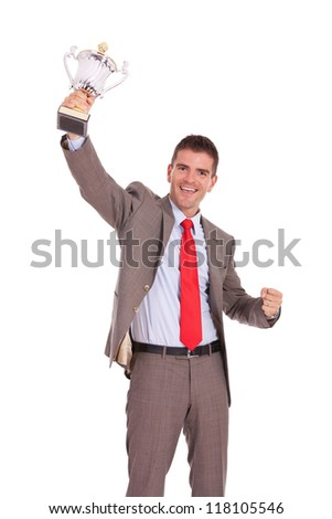 Business man cheering with winner's trophy on white background