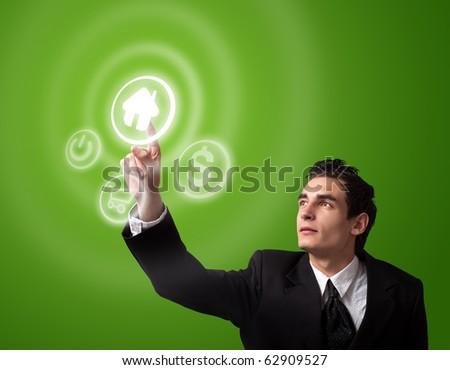 business man choosing home button - stock photo