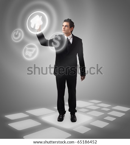 Business man choosing home button, futuristic digital technology - stock photo