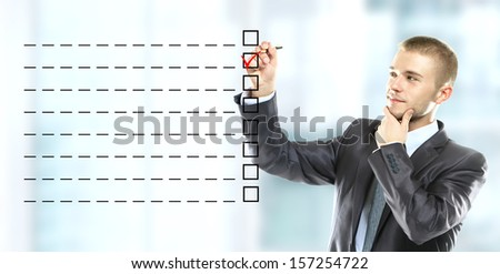Business Man choosing one of many options - stock photo