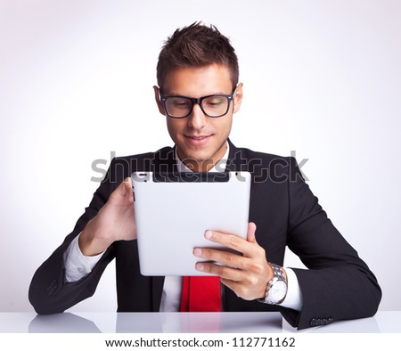 business man choosing something on his pad by tapping it's touchscreen