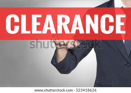 Business man Clearance word touching on red tab virtual screen for business concept - stock photo