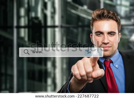 Business man clicking a search button - stock photo