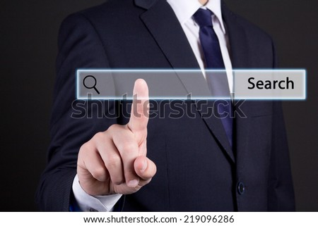 business man clicking internet search page on computer touch screen - stock photo