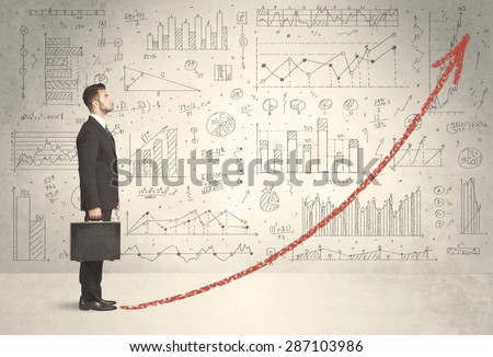 Business man climbing on red graph arrow concept on background - stock photo