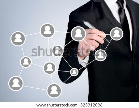 Business man close-up write people network - stock photo