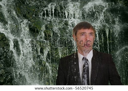 business man concept image back to nature  waterfall cleanse - stock photo
