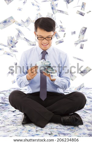business man counting money with money rain background