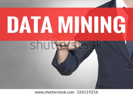 Business man Data Mining word touching on red tab virtual screen for business concept - stock photo
