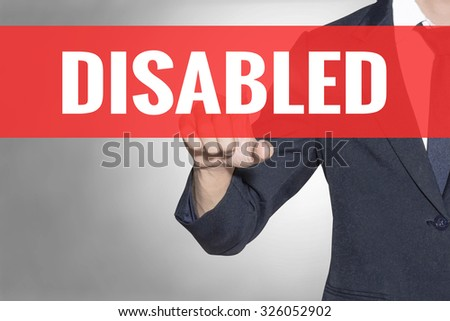 Business man Disabled word touching on red tab virtual screen for business concept - stock photo