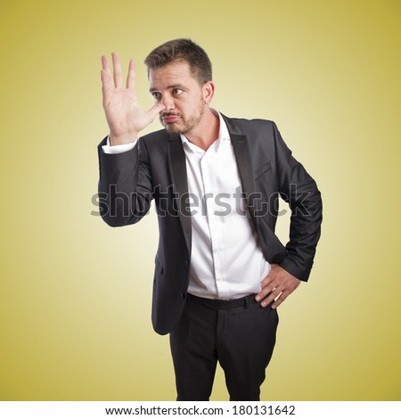 Business man doing a funny pose over orange gradient background