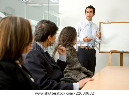 business man doing a presentation in an office - stock photo