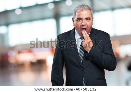 business man doing a vomit gesture - stock photo