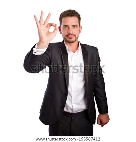 Business man doing ok gesture