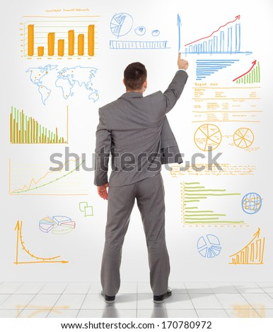 Business man draw graph finance chart diagram, back view businessman drawing sketches on wall, full length - stock photo