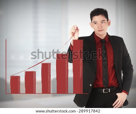 Business man draw increasing chart with office background - stock photo