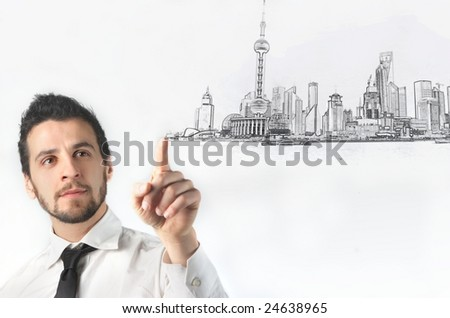 business man drawing a city - stock photo