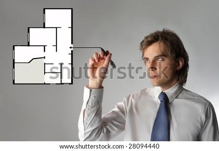 Business man drawing an digital blueprint - stock photo