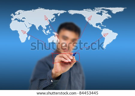 Business man drawing global network on world map