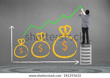 Business man drawing growing green graph with money bag symbol - stock photo