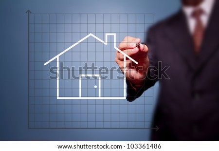 business man drawing house - stock photo
