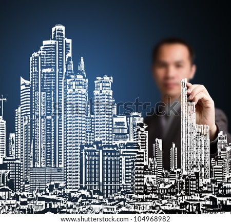 business man drawing industrial construction concept ( modern urban city building ) - stock photo