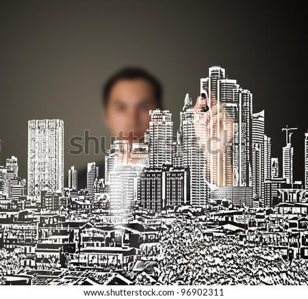 business man drawing urban city building development on whiteboard - stock photo