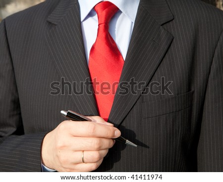 business man dressed with red tie