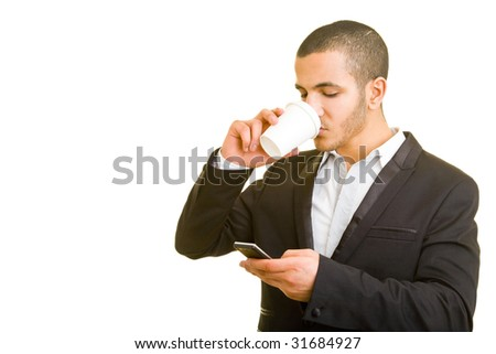 Business man drinking coffee and using his cell phone - stock photo