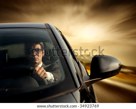 business man driving a car - stock photo