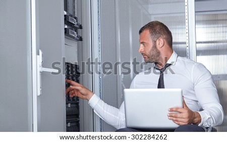 business man engeneer in modern datacenter server room - stock photo