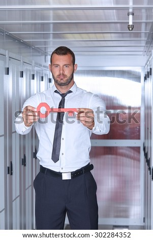 business man engeneer with key in datacenter server room - stock photo