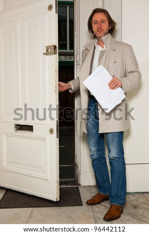 Business man entering office - stock photo
