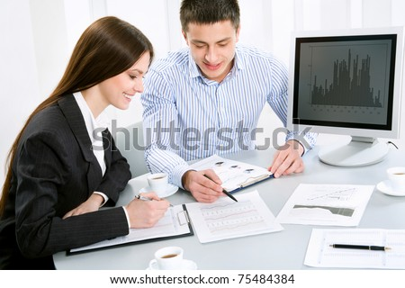 Business man explaining a new project to colleague - stock photo
