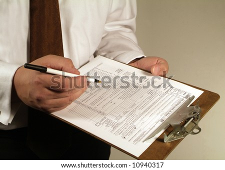 business man fills out a tax form