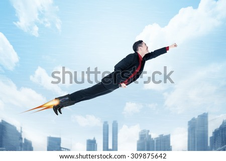 Business man flying with rocket on his shoes.Job promotion concept