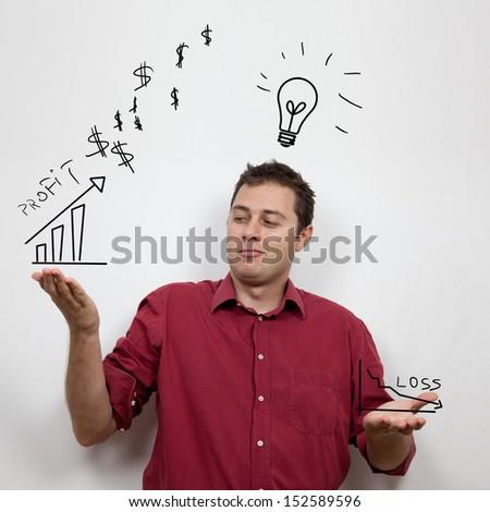 Business man gazing at profit - stock photo