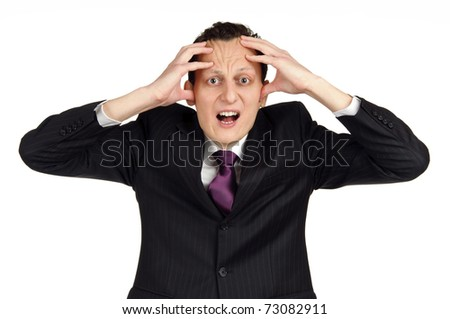 Business man getting crazy. Studio shot isolated on white background - stock photo