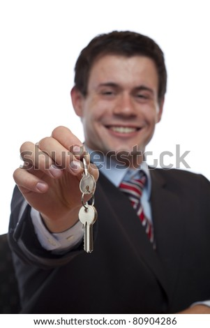 Business man gives over house key. Isolated on white background. - stock photo