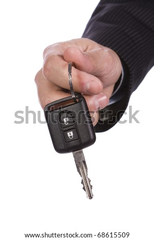 Business man giving a new key car