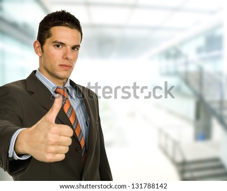 business man going thumb up at the office - stock photo