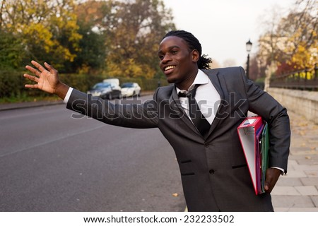 business man hailing a taxi - stock photo