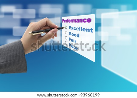 Business Man Hand Check on Excellent Choice on Annual Performance Evaluation audit - stock photo