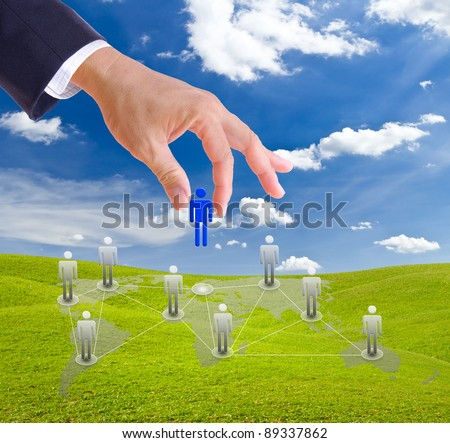 business man hand choosing people from social network - stock photo