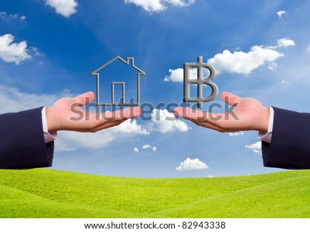 business man hand exchange baht sign and house icon