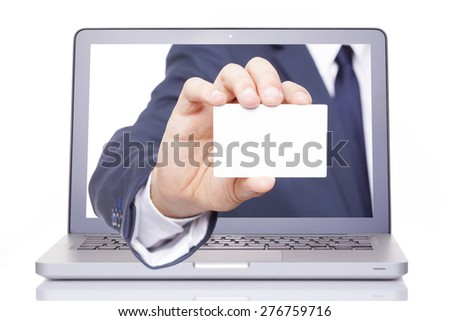 Business man hand giving a business card through a laptop, isolated on white background